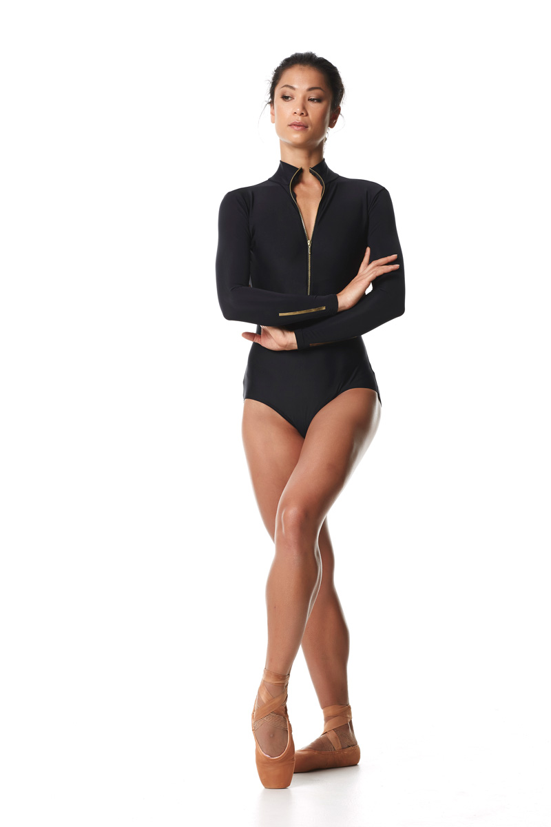 Leotard from Keto Dancewear Black Collection, a perfect addition to any ballerina's rehearsal wardrobe. Ft Long sleeves, collar, open back & gold zipper. Ballet bodysuit.